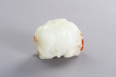 Lot 168 - A PALE CELADON AND RUSSET JADE 'BOYS AND ELEPHANT' GROUP, LATE QING TO REPUBLIC