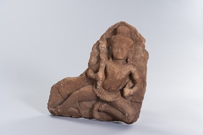 A KHMER SANDSTONE RELIEF OF A DEITY