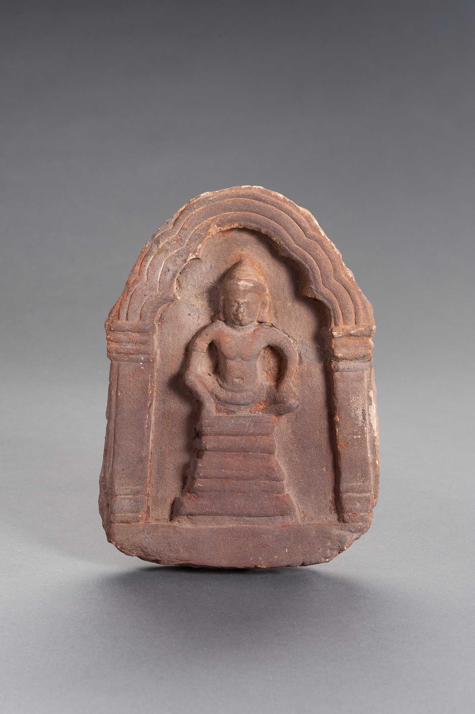 A KHMER SANDSTONE VOTIVE PLAQUE OF BUDDHA