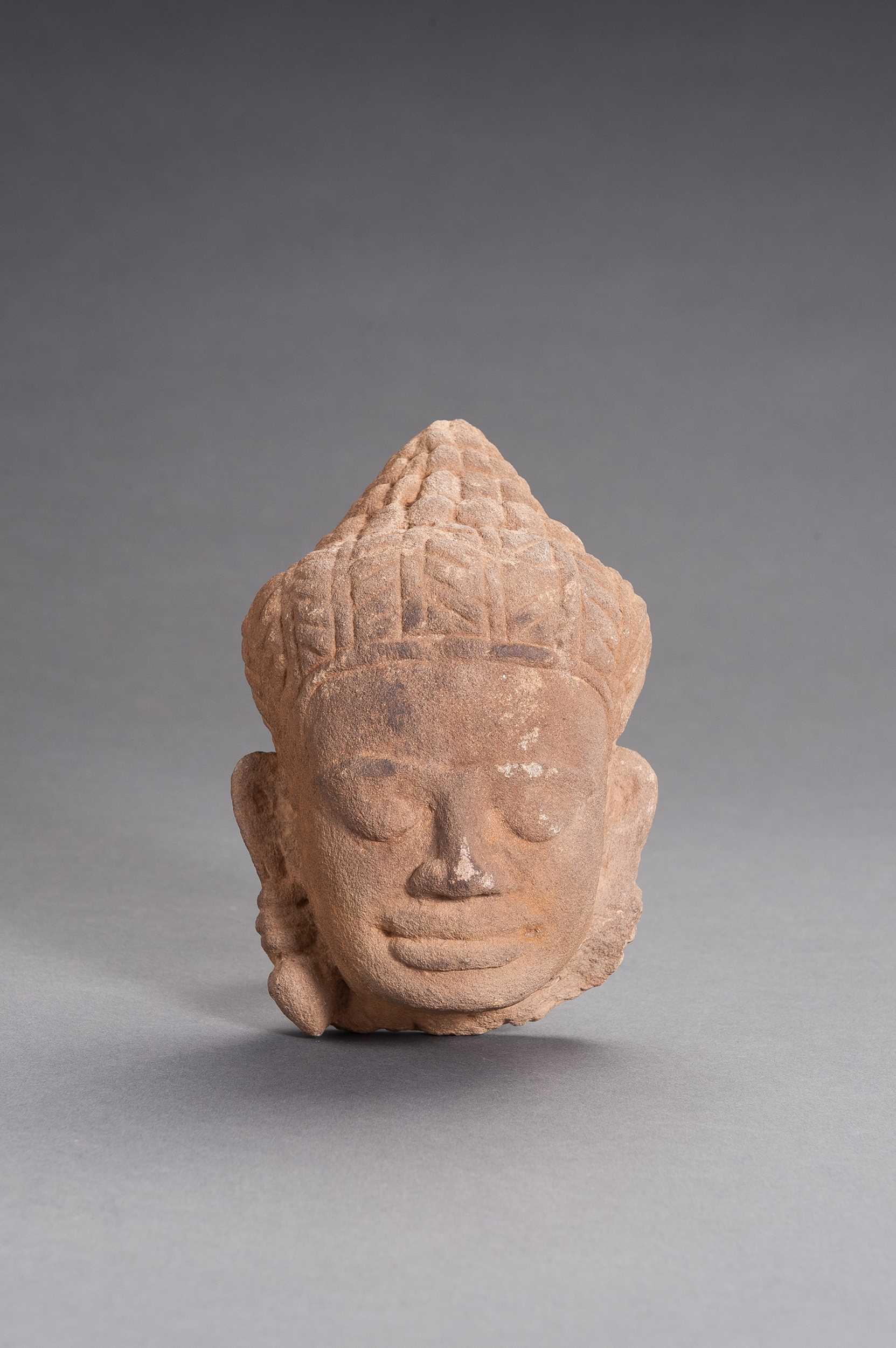 A KHMER SANDSTONE HEAD OF BUDDHA