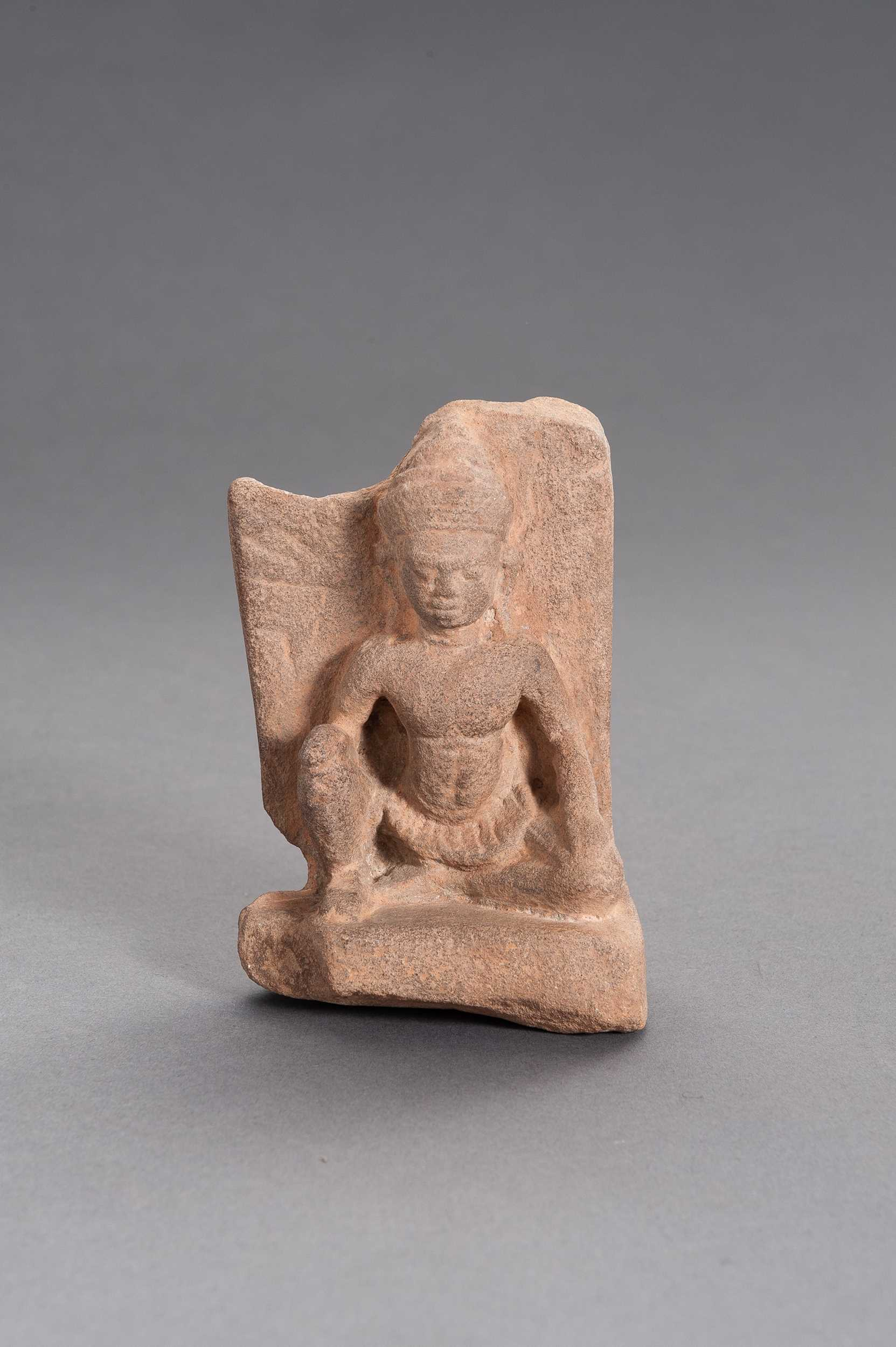 A SMALL KHMER SANDSTONE RELIEF OF BUDDHA