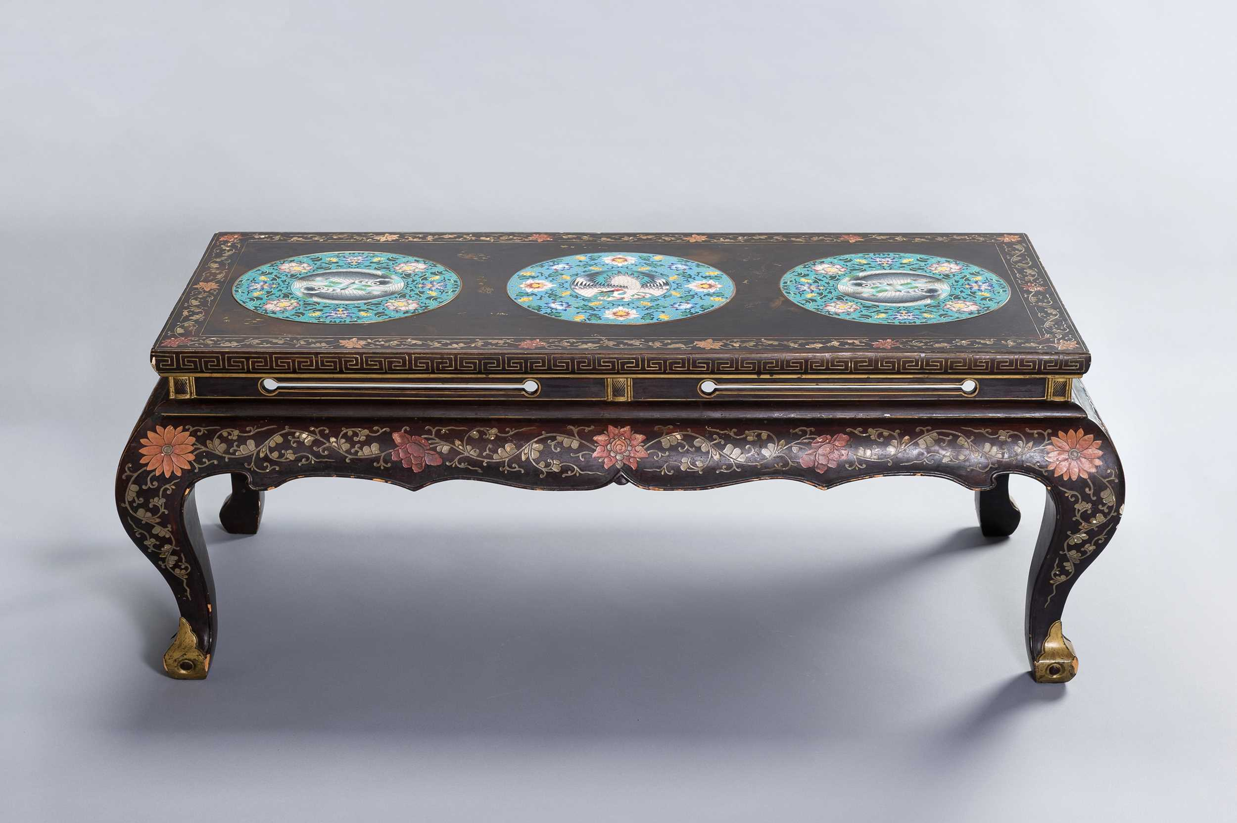 Lot 146 - A CHINESE LACQUERED COFFEE TABLE WITH CLOISONNÉ PLAQUES