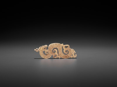 A SMALL JADE PENDANT DEPICTING A COILED DRAGON