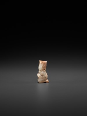 A WHITE JADE CARVING OF A KNEELING FIGURE