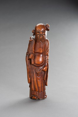 A CARVED BAMBOO FIGURE OF AN IMMORTAL