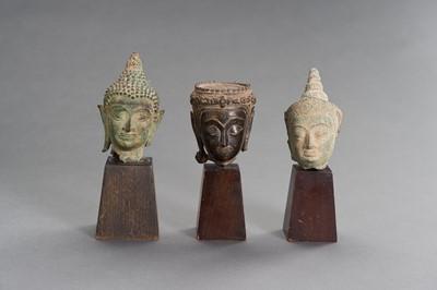 Lot 505 - A LOT WITH THREE BRONZE BUDDHA HEADS