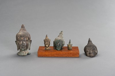 Lot 506 - A LOT WITH FIVE SMALL BRONZE BUDDHA HEADS