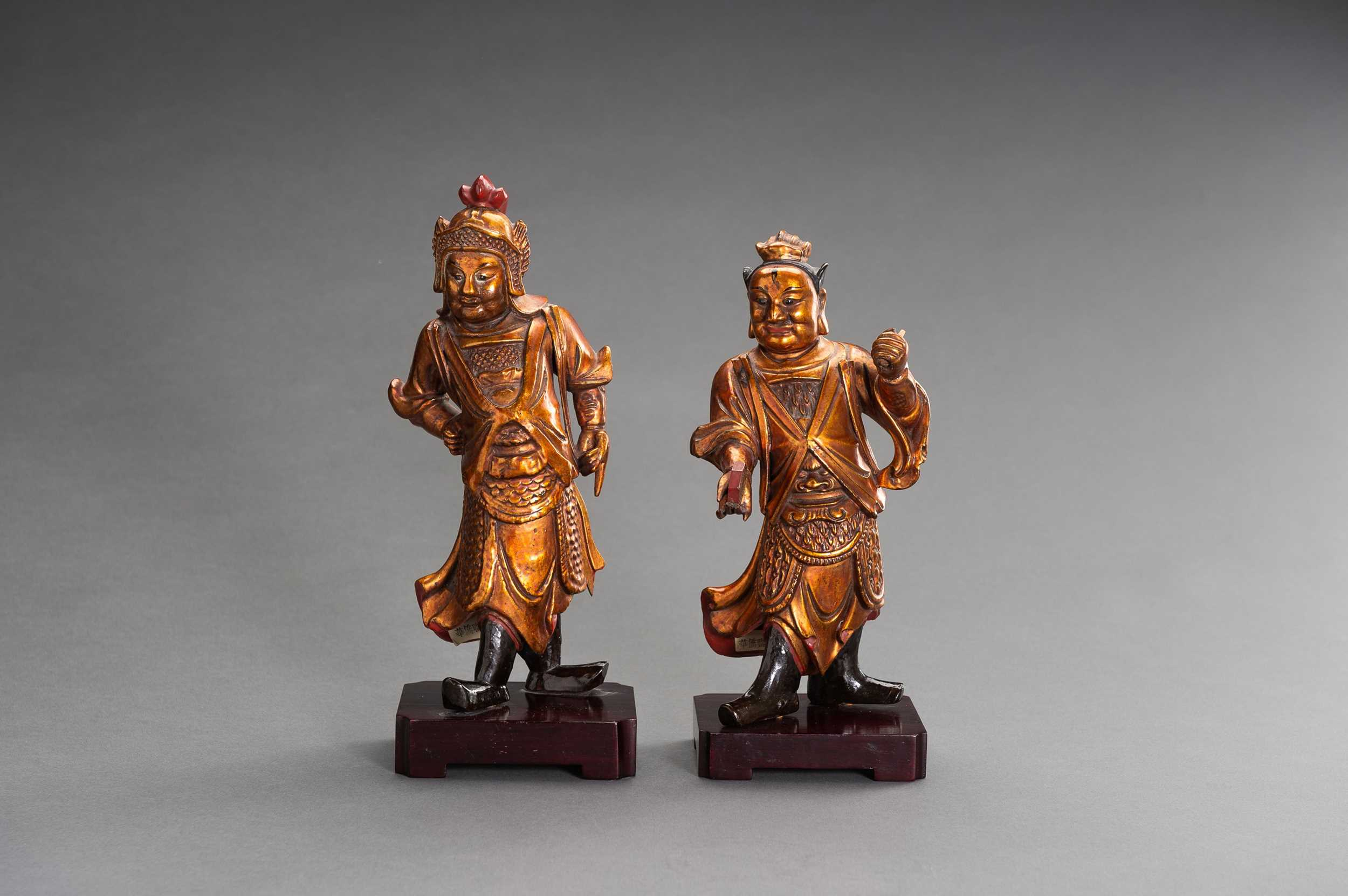 Lot 140 - A PAIR OF GILT-LACQUERED 'HEAVENLY GUARDIAN' WOOD FIGURES