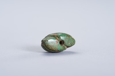 A TURQUOISE MINIATURE PENDANT OF TWO CRANES