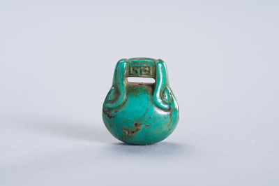 Lot 234 - A TURQUOISE MINIATURE PENDANT OF A TEMPLE BELL