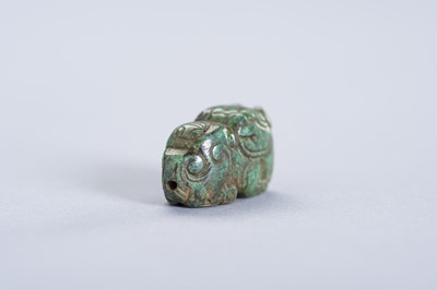 Lot 227 - A TURQUOISE MINIATURE PENDANT OF A BUDDHIST LION