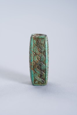 A TURQUOISE PENDANT OF AN ARCHAISTIC BEAD