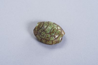 A TURQUOISE PENDANT OF A TORTOISE SHELL