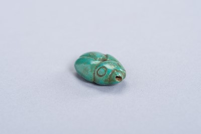 A TURQUOISE PENDANT OF A BIRD