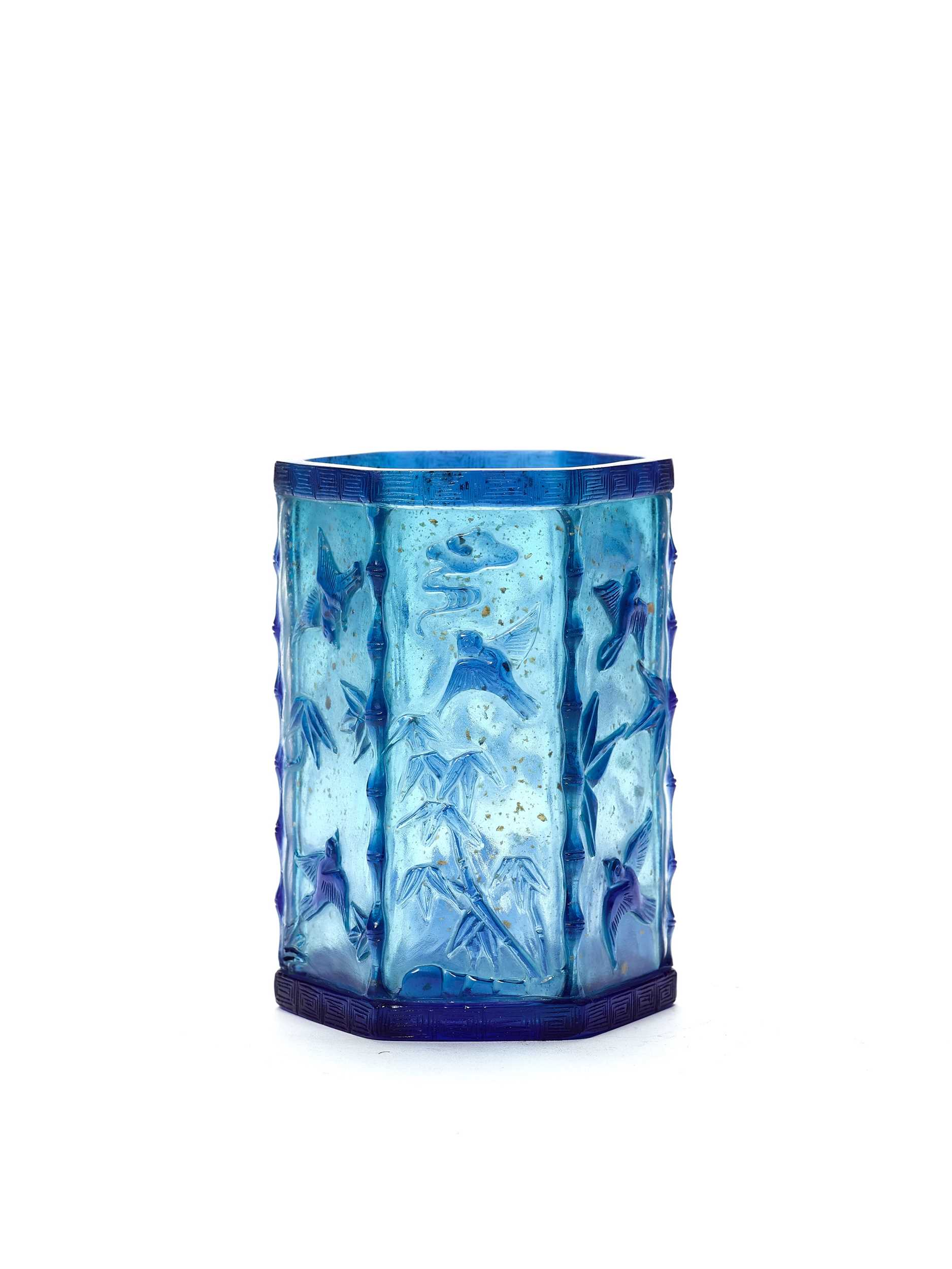Lot 86 - A CARVED HEXAGONAL BLUE OVERLAY GLASS BRUSH POT, QING DYNASTY