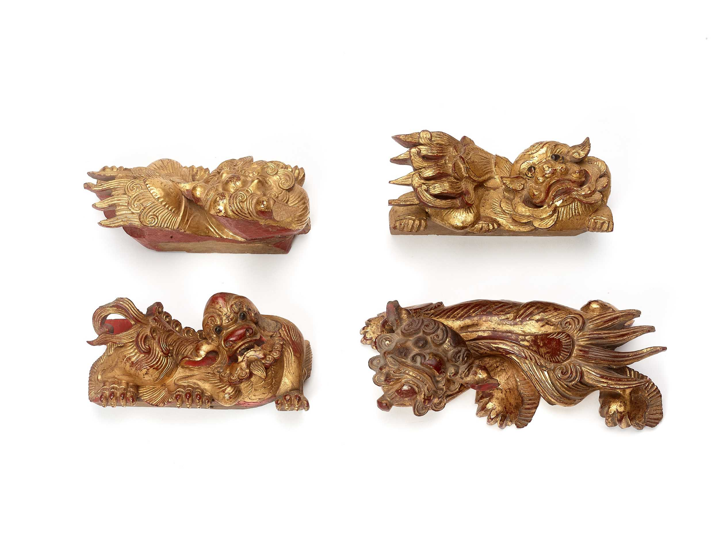 Lot 139 - FOUR CHINESE GILT LACQUERED BUDDHIST LION WALL HANGINGS