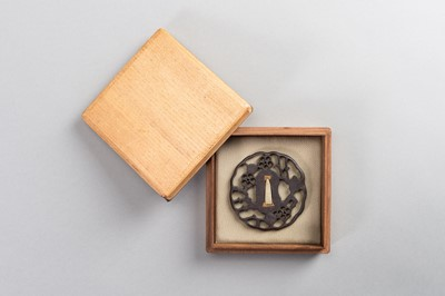 Lot 44 - AN IRON SUKASHI-TSUBA WITH FLOWERS AND CLOUDS