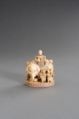 Lot 250 - CHIKUYÔSAI TOMOCHIKA: AN IMPRESSIVE IVORY OKIMONO OF A CAPARISONED ELEPHANT WITH BOYS