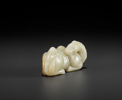 Lot 87 - A PALE YELLOW JADE FIGURE OF A CAMEL, MING DYNASTY
