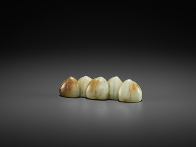 Lot 81 - A CELADON AND RUSSET JADE 'FIVE PEACHES' BRUSH REST, MING DYNASTY