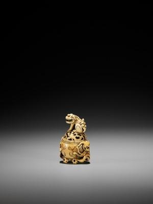 Lot 26 - A RARE IVORY NETSUKE OF A KORO (INCENSE BURNER) WITH SHISHI