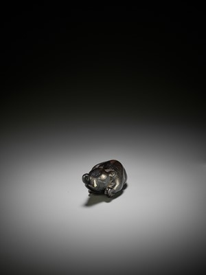 Lot 38 - A LARGE AND OLD DARK WOOD NETSUKE OF A RECUMBENT BOAR