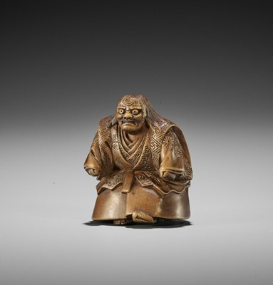 Lot 187 - HOJITSU: A WOOD NETSUKE OF A NOH ACTOR IN THE ROLE OF HANNYA