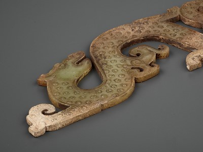 Lot 68 - AN ALTERED CELADON JADE 'DRAGON AND PHOENIX' SILHOUETTE PENDANT, WARRING STATES