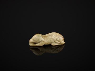 Lot 85 - A CELADON AND RUSSET JADE FIGURE OF A DOG, SONG TO MING DYNASTY