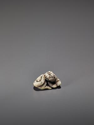 Lot 269 - AN IVORY OSAKA STYLE NETSUKE OF A RECLINING TIGER