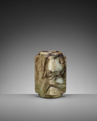 Lot 74 - A GREEN AND BROWN NEPHRITE ARCHAISTIC CONG, MING DYNASTY