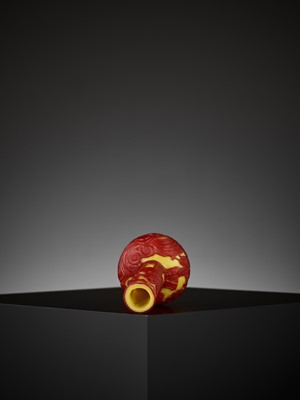 Lot 18 - A CARVED RED-OVERLAY YELLOW GLASS BOTTLE VASE, QIANLONG MARK AND PERIOD