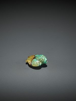 Lot 59 - A TURQUOISE PENDANT DEPICTING A BIRD, SHANG TO WESTERN ZHOU DYNASTY