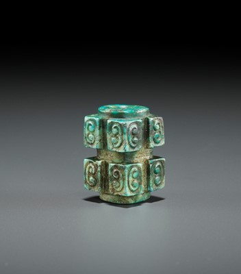 Lot 55 - A TURQUOISE CONG-FORM BEAD, SHANG TO WESTERN ZHOU DYNASTY