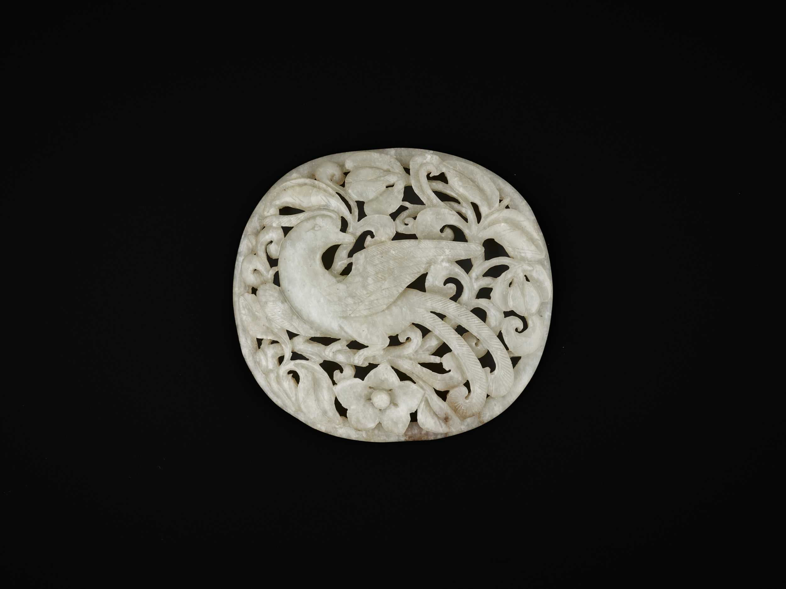Lot 91 - A PALE CELADON JADE RETICULATED 'PHEASANT' PLAQUE, MING DYNASTY