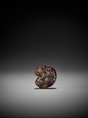 Lot 80 - TOYOKAZU: A FINE WOOD NETSUKE OF A SHISHI PLAYING WITH A BALL