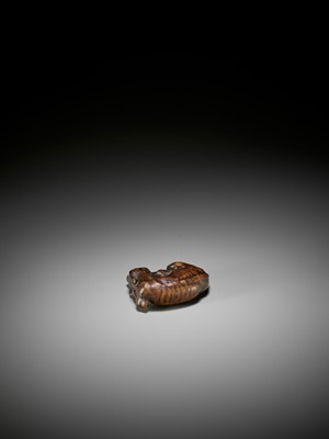 Lot 59 - MASATOMO: A FINE WOOD NETSUKE OF A RECUMBENT DEER