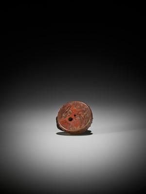 Lot 94 - MASATAMI: A WOOD NETSUKE OF A COCKEREL ON A WAR DRUM