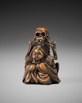 Lot 130 - A WOOD NETSUKE OF A SKELETON MASSAGING OKAME, IN THE STYLE OF SHOKO
