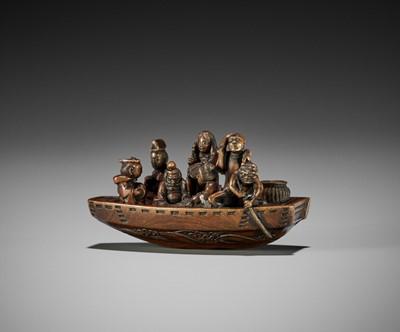 Lot 180 - IKKOSAI: A WOOD NETSUKE OF TRAVELERS IN A FERRYBOAT