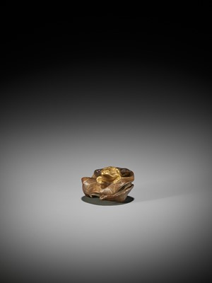 Lot 85 - TOMONOBU: A RARE LACQUERED WOOD NETSUKE OF A GOLDEN FROG ON A LOTUS LEAF