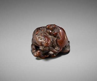 Lot 111 - KOKEI: A RARE WOOD NETSUKE OF A HORSE WITH YOUNG