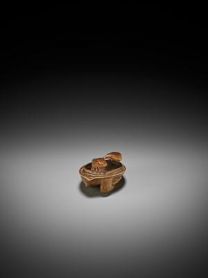 Lot 86 - SHIGEMASA: A FINE AND RARE WOOD NETSUKE OF A CRAB ON AWABI