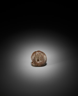 Lot 18 - A RARE WOOD NETSUKE OF A NINGYO (MERMAID)