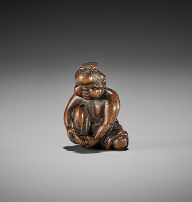 Lot 147 - A CHARMING OLD WOOD NETSUKE OF OKAME CLIPPING HER TOENAILS