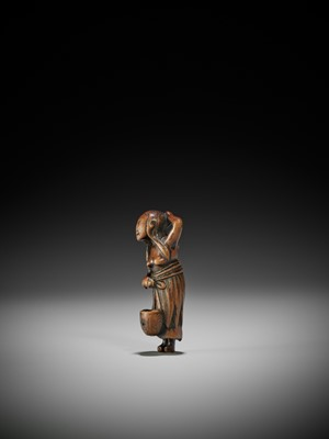 Lot 20 - AN OLD WOOD NETSUKE OF A DIVING GIRL (AMA)