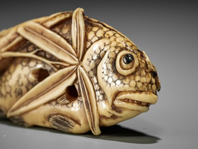 Lot 70 - KOSEN: A FINE IVORY NETSUKE OF TWO FISH AND BAMBOO
