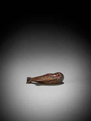 Lot 17 - AN UNUSUAL WOOD NETSUKE OF A SWIMMING NINGYO (MERMAID)