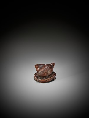 Lot 55 - OKATOMO: A RARE STAINED WOOD NETSUKE OF TWO QUAILS ON MILLET