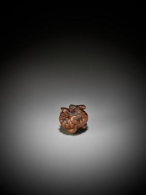 Lot 87 - SHIGEMASA: A FINE WOOD NETSUKE OF A PUMPKIN WITH TWO SNAKES